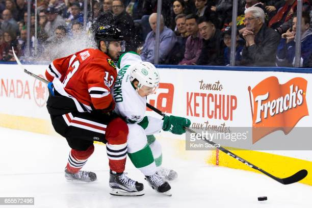 Alexey Marchenko of the Toronto Maple Leafs battles for the puck against Tomas Jurco of the Chicago Blackhawks during the third period at the Air...