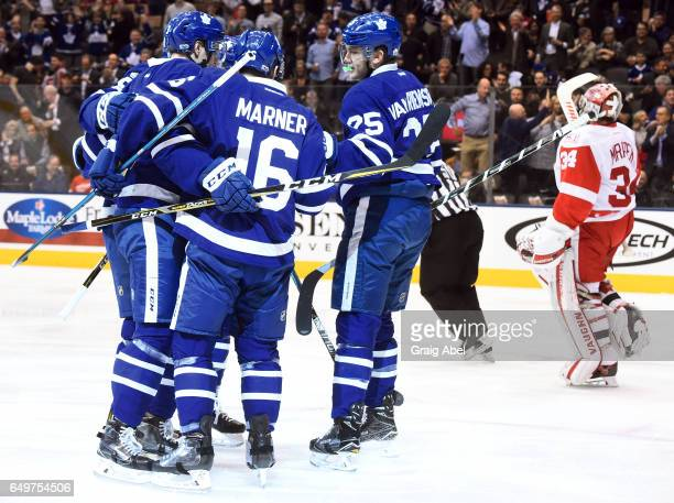 Alexey Marchenko of the Toronto Maple Leafs celebrates his goal on Petr Mrazek of the Detroit Red Wings with teammates Mitch Marner and James van...
