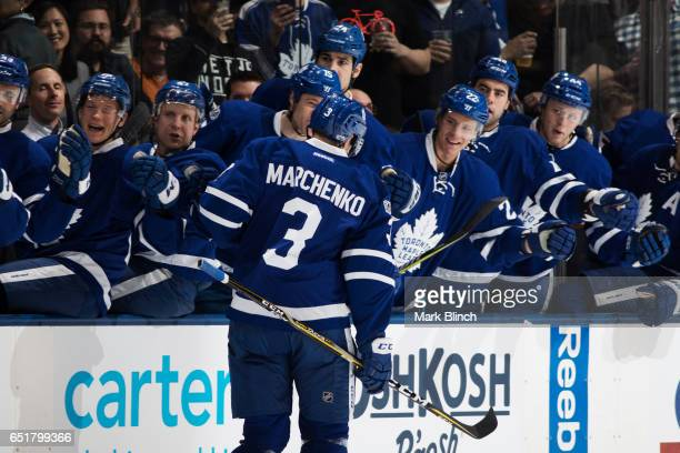 Alexey Marchenko of the Toronto Maple Leafs celebrates his goal with teammates against the Detroit Red Wings during the first period at the Air...