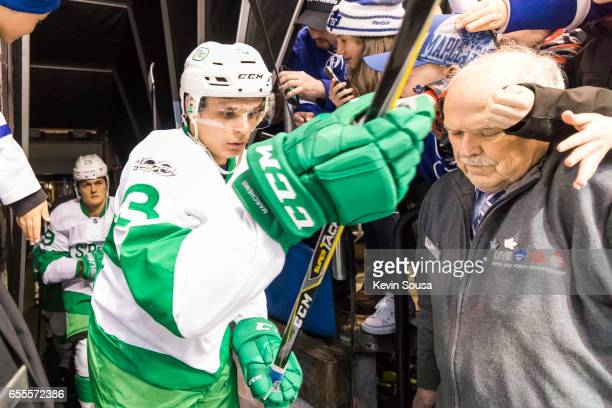 Alexey Marchenko of the Toronto Maple Leafs is surrounded by fans prior at an NHL game against the Chicago Blackhawks at the Air Canada Centre on...