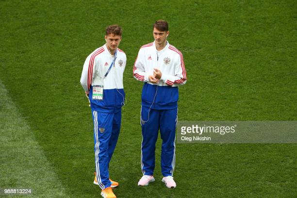 Alexey Miranchuk and Anton Miranchuk of Russia look on during pitch inspection prior to the 2018 FIFA World Cup Russia Round of 16 match between...