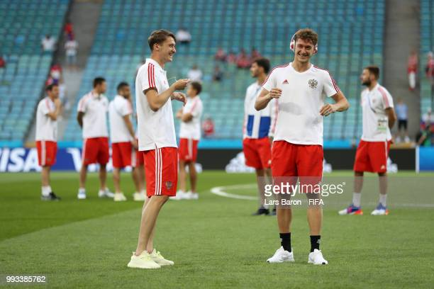 Alexey Miranchuk and Anton Miranchuk of Russia smile during pitch inspection prior to the 2018 FIFA World Cup Russia Quarter Final match between...
