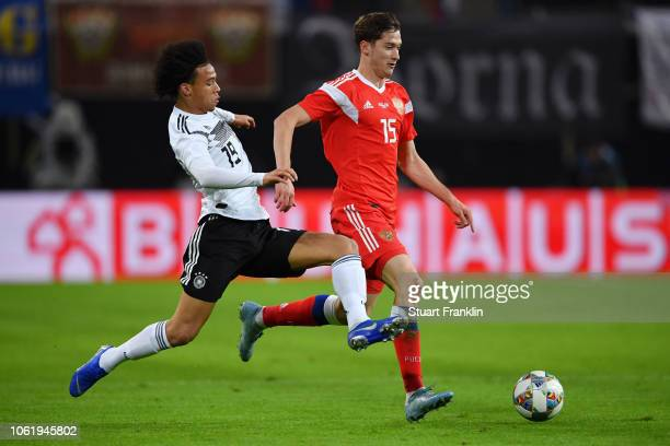 Alexey Miranchuk of Russia is challenged by Leroy Sane of Germany prior to the International Friendly match between Germany and Russia at Red Bull...