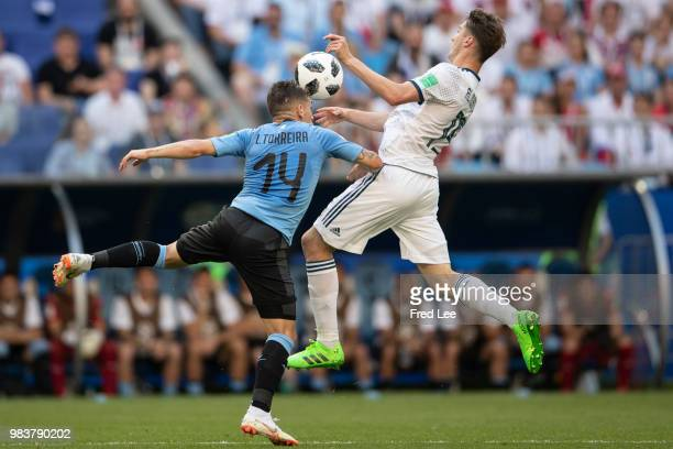 Alexey Miranchuk of Russia is challenged by Lucas Torreira of Uruguay during the 2018 FIFA World Cup Russia group A match between Uruguay and Russia...