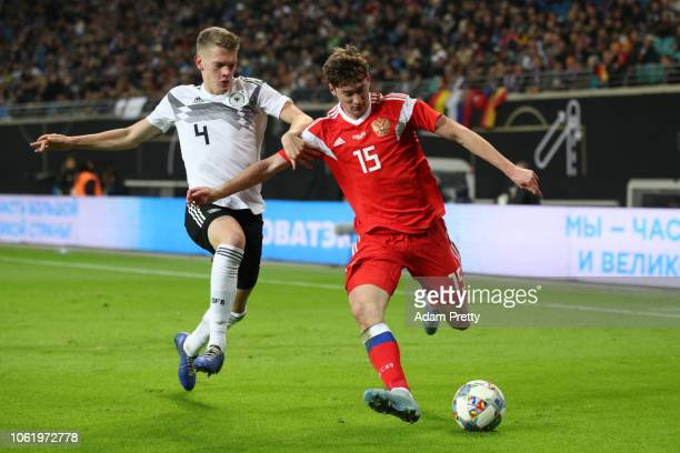 Alexey Miranchuk of Russia is challenged by Matthias Ginter of Germany during the International Friendly match between Germany and Russia at Red Bull...