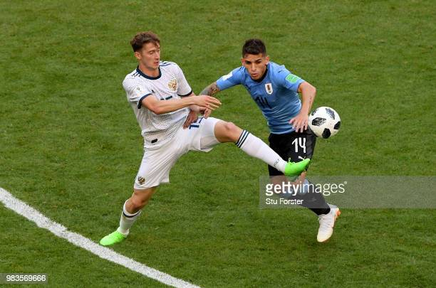 Alexey Miranchuk of Russia tackles Lucas Torreira of Uruguay during the 2018 FIFA World Cup Russia group A match between Uruguay and Russia at Samara...