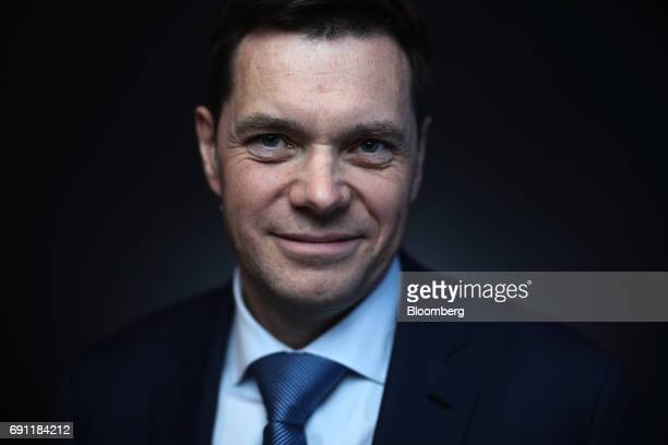 Alexey Mordashov billionaire and chairman of Severstal PAO poses for a photograph following a Bloomberg Television interview and during the St...