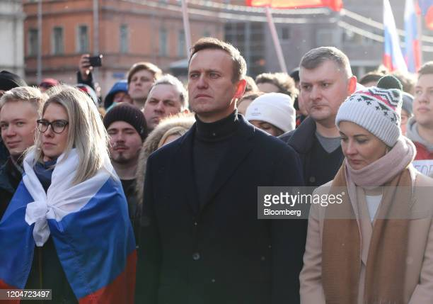 Alexey Navalny, Russian opposition leader, center, and his wife Yulia, right, walk with demonstrators during a rally in Moscow, Russia, on Saturday,...