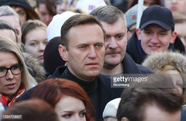 Alexey Navalny, Russian opposition leader, center, walks with demonstrators during a rally in Moscow, Russia, on Saturday, Feb. 29, 2019. The rally...
