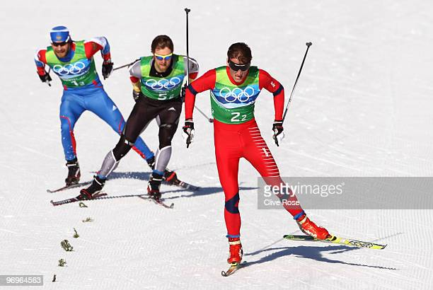 Alexey Petukhov of Russia Axel Teichmann of Germany and Petter Northug of Norway compete during the cross country skiing men's team sprint semifinal...