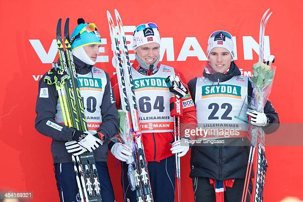 Alexey Poltoranin of Kazakhstan Paal Golberg of Norway and Didrik Toenseth of Norway pose on the podium during the FIS CrossCountry World Cup Men's...