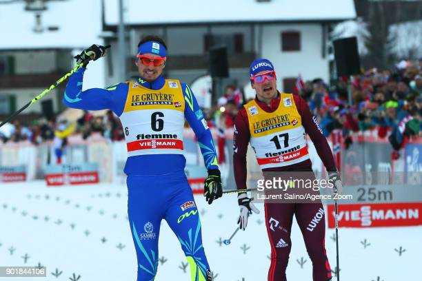 Alexey Poltoranin of Kazakhstan takes 1st place Andrey Larkov of Russia takes 2nd place during the FIS Nordic World Cup Men's CC 15 km C Mass Start...