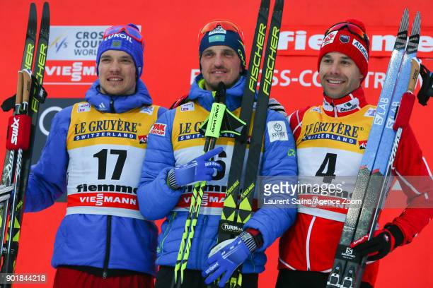 Alexey Poltoranin of Kazakhstan takes 1st place Andrey Larkov of Russia takes 2nd place Alex Harvey of Canada takes 3rd place during the FIS Nordic...