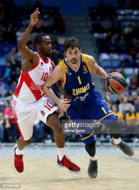 Alexey Shved #1 of Khimki Moscow Region competes with Rodrigue Beaubois #10 of Baskonia Vitoria Gasteiz in action during the 2017/2018 Turkish...