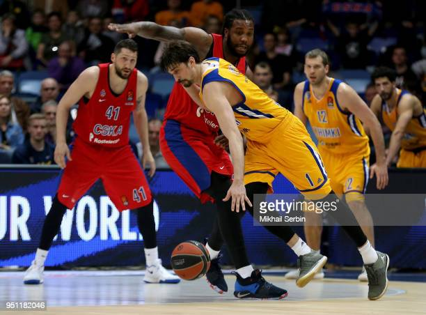 Alexey Shved #1 of Khimki Moscow Region competes with Victor Rudd #3 of CSKA Moscow in action during the Turkish Airlines Euroleague Play Offs Game 3...
