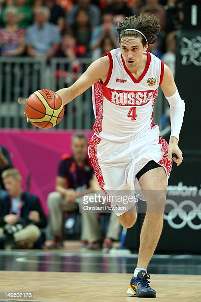 Alexey Shved of Russia dribbles the ball against Great Britain during their Men's Basketball Game on Day 2 of the London 2012 Olympic Games at the...