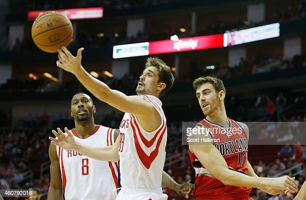 Alexey Shved of the Houston Rockets battles for the basketball with Victor Claver of the Portland Trail Blazers during their game at the Toyota...