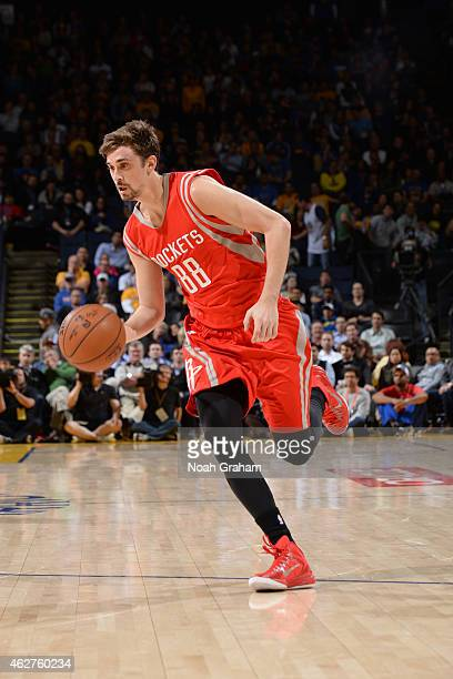 Alexey Shved of the Houston Rockets drives against the Golden State Warriors on January 21 2015 at Oracle Arena in Oakland California NOTE TO USER...