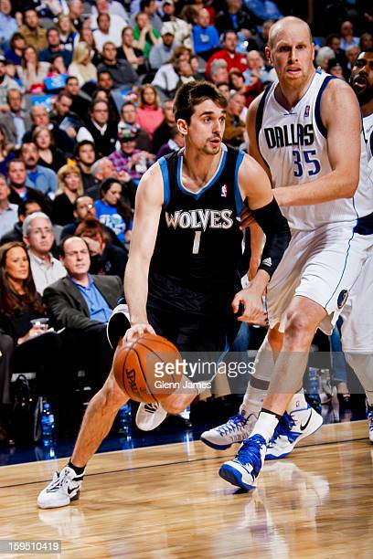Alexey Shved of the Minnesota Timberwolves drives against Chris Kaman of the Dallas Mavericks on January 14 2013 at the American Airlines Center in...