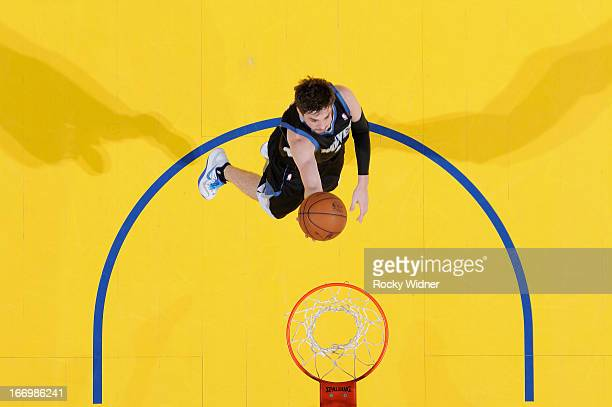 Alexey Shved of the Minnesota Timberwolves shoots a layup against the Golden State Warriors on April 9 2013 at Oracle Arena in Oakland California...