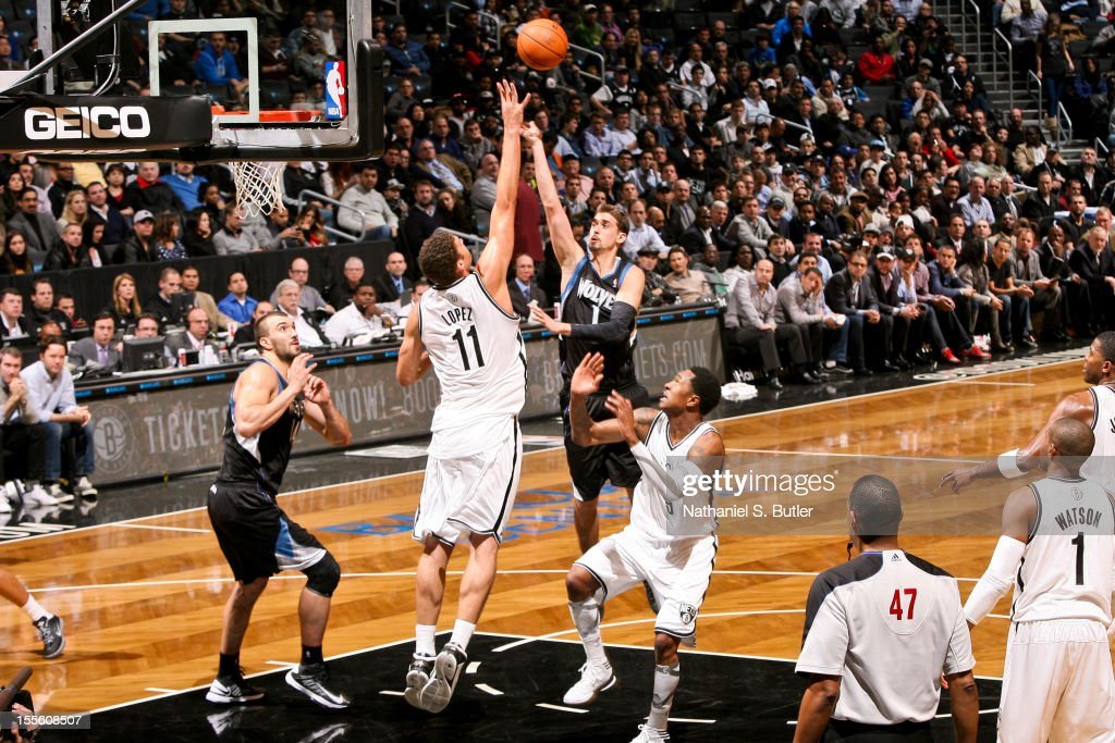 Alexey Shved #1 of the Minnesota Timberwolves shoots against Brook Lopez #11 of the Brooklyn Nets on November 5, 2012 at the Barclays Center in Brooklyn, New York.