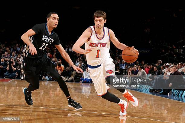 Alexey Shved of the New York Knicks drives against Kevin Martin of the Minnesota Timberwolves on March 19 2015 at Madison Square Garden in New York...