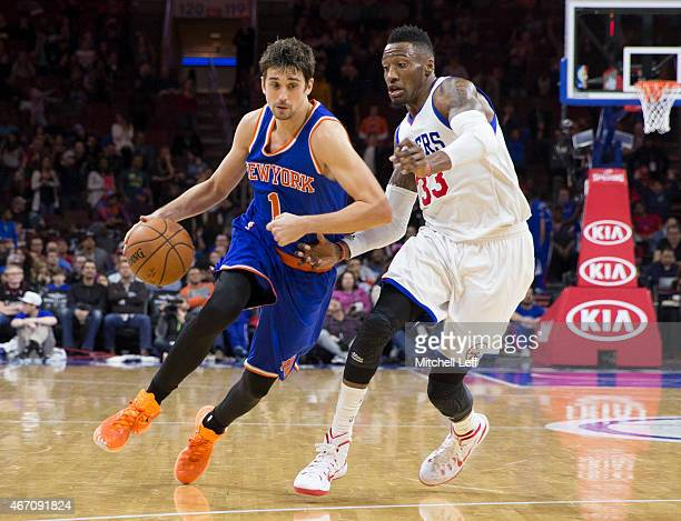 Alexey Shved of the New York Knicks drives past Robert Covington of the Philadelphia 76ers on March 20 2015 at the Wells Fargo Center in Philadelphia...
