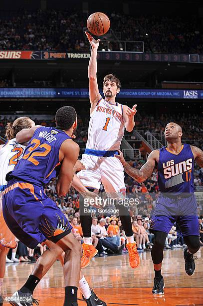 Alexey Shved of the New York Knicks shoots against the Phoenix Suns on March 15 2015 at US Airways Center in Phoenix Arizona NOTE TO USER User...