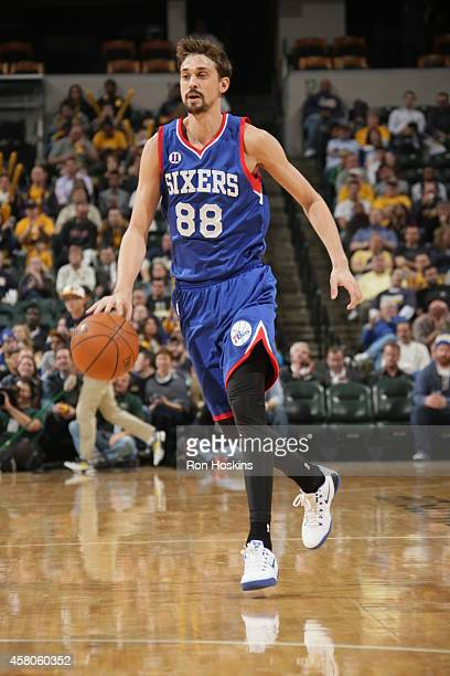 Alexey Shved of the Philadelphia 76ers brings the ball up court against the Indiana Pacers at Bankers Life Fieldhouse on October 29 2014 in...