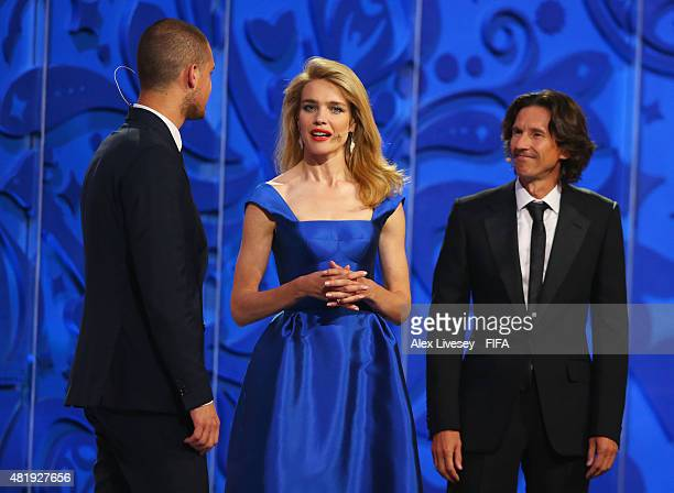 Alexey Smertin and Draw assistant Predrag Rajkovic on stage with presenter Natalia Vodianova at the Preliminary Draw of the 2018 FIFA World Cup in...