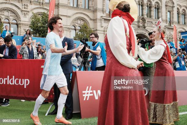 """Alexey Smertin is being greeted during the Legends Football Match in """"The park of Soccer and rest"""" at Red Square on July 11, 2018 in Moscow, Russia."""