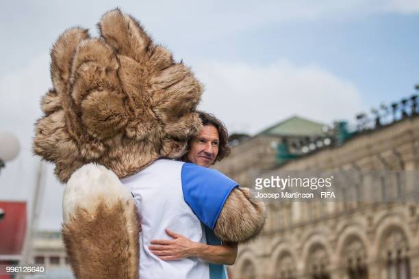 Alexey Smertin is being hugged by Zabivaka during the Legends Football Match in Red Square on July 11, 2018 in Moscow, Russia.