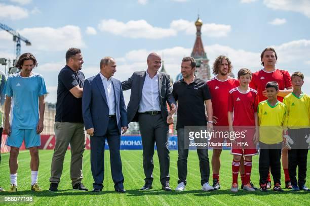 Alexey Smertin, Ronaldo, Vladimir Putin, Gianni Infantino, Lothar Matthaus, Carles Puyol and Dmitry Bulykin pose during Football Event in Red Square...