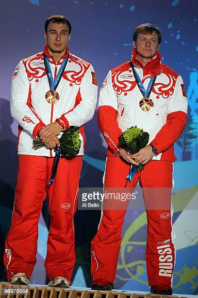 Alexey Voevoda and Alexsandr Zubkov of Russia receive the bronze medal during the medal ceremony for the men's twoman bobsleigh on day 11 of the...