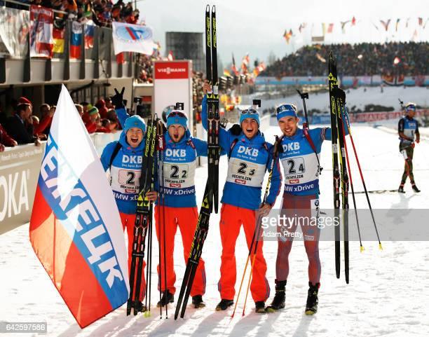 Alexey Volkov, Maxim Tsvetkov, Anton Babikov and Anton Shipulin of Russia celebrate victory in the Men's 4x 7.5km relay competition of the IBU World...