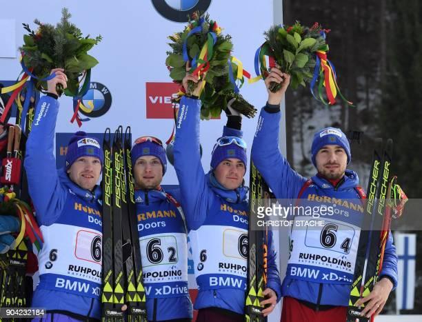 Alexey Volkov Maxim Tsvetkov Anton Babikov and Anton Shipulin of Russia celebrate placing 3rd on the podium after the men's 4 x 75km relay event at...