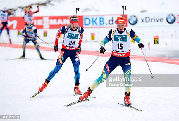 Alexey Volkov of Russia and Serhiy Semenov of Ukraine compete during the IBU Biathlon World Cup Men's 125 km pursuit race on March 22 2014 in Oslo...