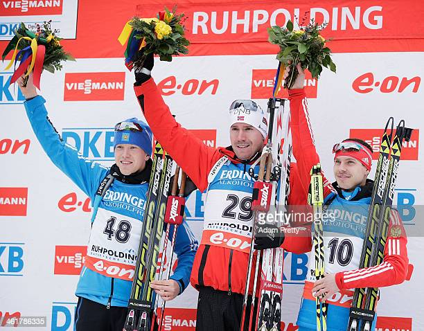 Alexey Volkov of Russia Emil Hegle Svendsen of Norway and Evgeny Ustyugov of Russia celebrate on the podium after the 20km mens individual on day...