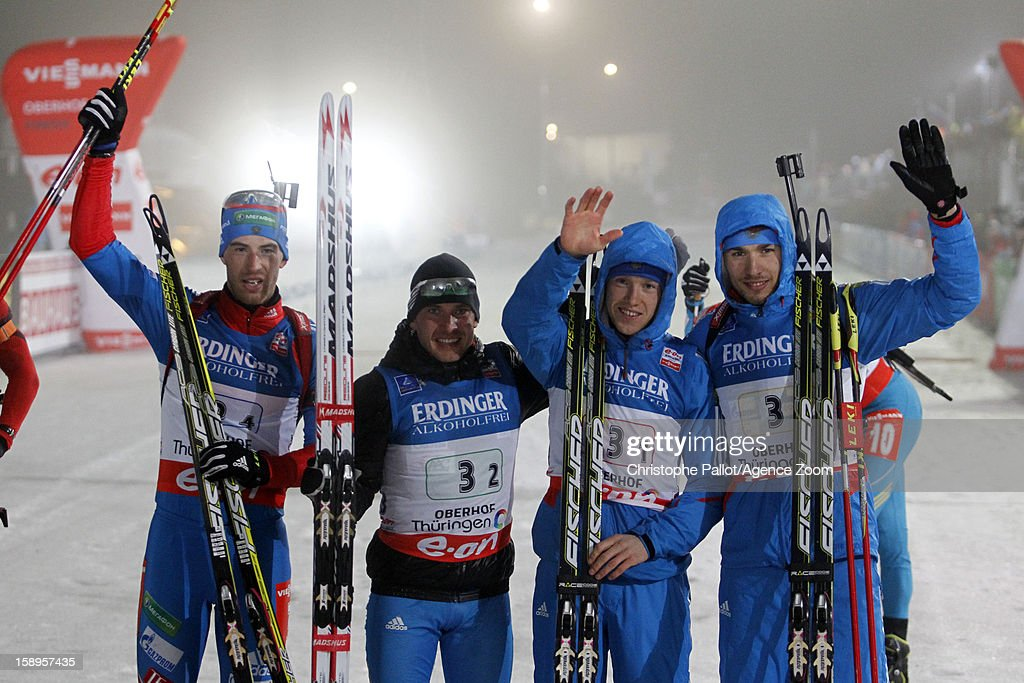 Alexey Volkov of Russia, Evgeniy Garanichev of Russia, Anton Shipulin of Russia, Dmitry Malyshko of Russia take 1st place during the IBU Biathlon World Cup Men's Relay on January 04, 2013 in Oberhof, Germany.