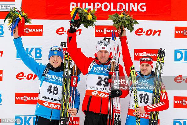 Alexey Volkov of Russia takes 2nd place Emil Hegle Svendsen of Norway takes 1st place Evgeny Ustyugov of Russia takes 3rd place during the IBU...
