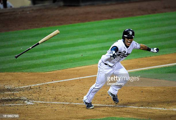 Alexi Amarista of the San Diego Padres celebrates after hitting a walkoff single during the eleventh inning of a baseball game against the Arizona...