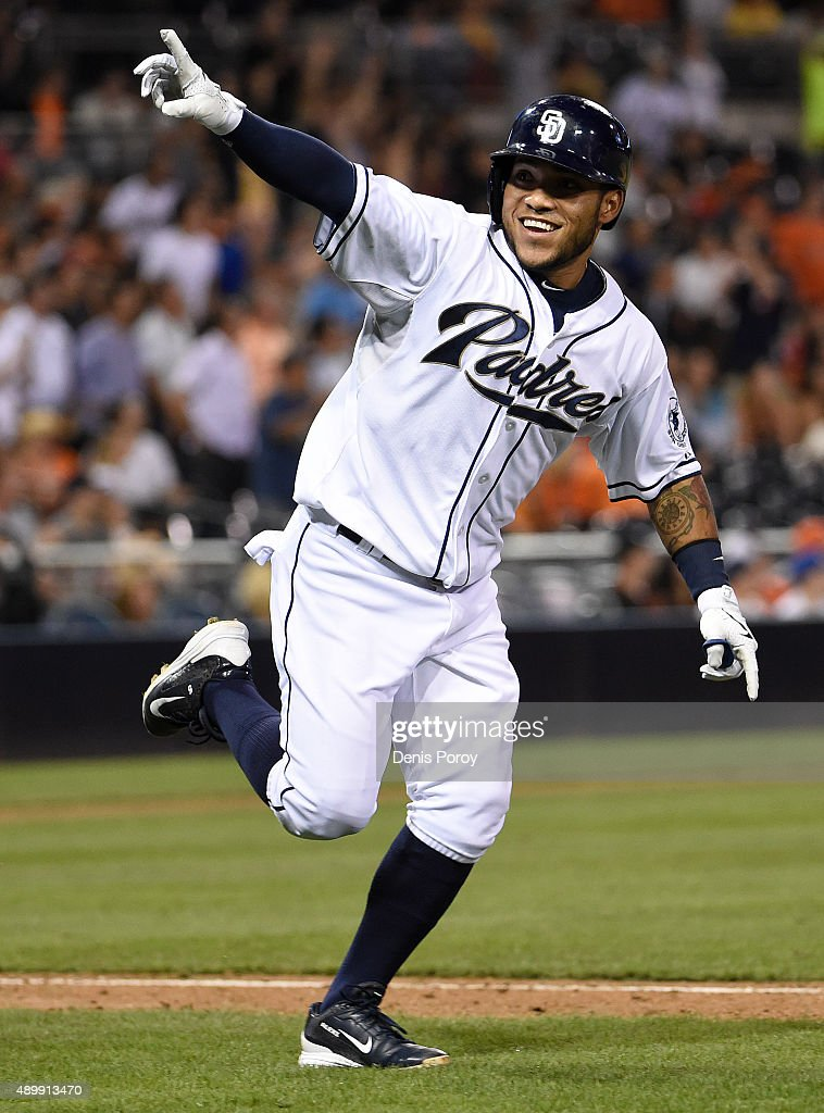 Alexi Amarista #5 of the San Diego Padres celebrates after hitting a walk-off single during the ninth inning of a baseball game against the San Francisco Giants at Petco Park September 24, 2015 in San Diego, California. The Padres won 5-4.