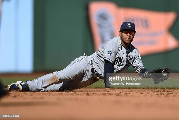 Alexi Amarista of the San Diego Padres flips the ball with his glove to get the force out at second base against the San Francisco Giants in the...