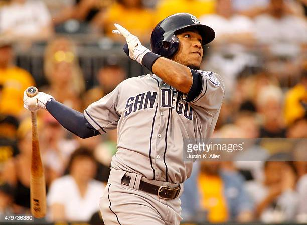 Alexi Amarista of the San Diego Padres hits a sacrifice fly in the second inning during the game against the Pittsburgh Pirates at PNC Park on July 6...