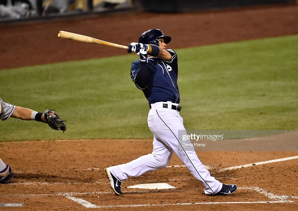 Alexi Amarista #5 of the San Diego Padres hits an RBI single during the sixth inning of a baseball game against the Colorado Rockies at Petco Park September, 23, 2014 in San Diego, California.