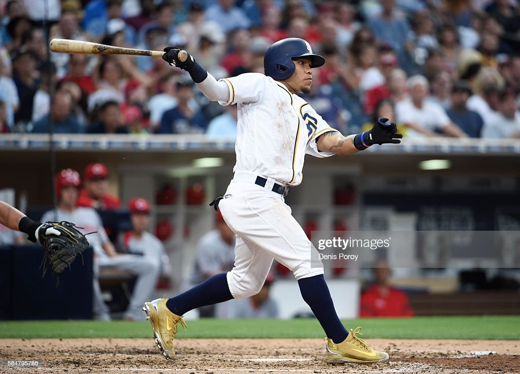 Alexi Amarista #5 of the San Diego Padres hits an RBI single during the sixth inning of a baseball game against the Cincinnati Reds at PETCO Park on July 30, 2016 in San Diego, California.