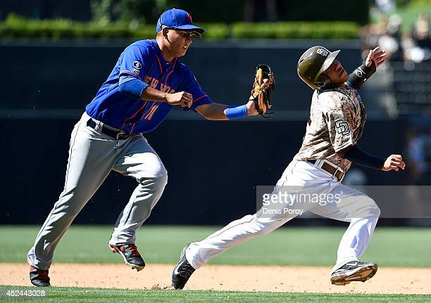 Alexi Amarista of the San Diego Padres is caught in a rundown by Ruben Tejada of the New York Mets during the ninth inning of a baseball game at...