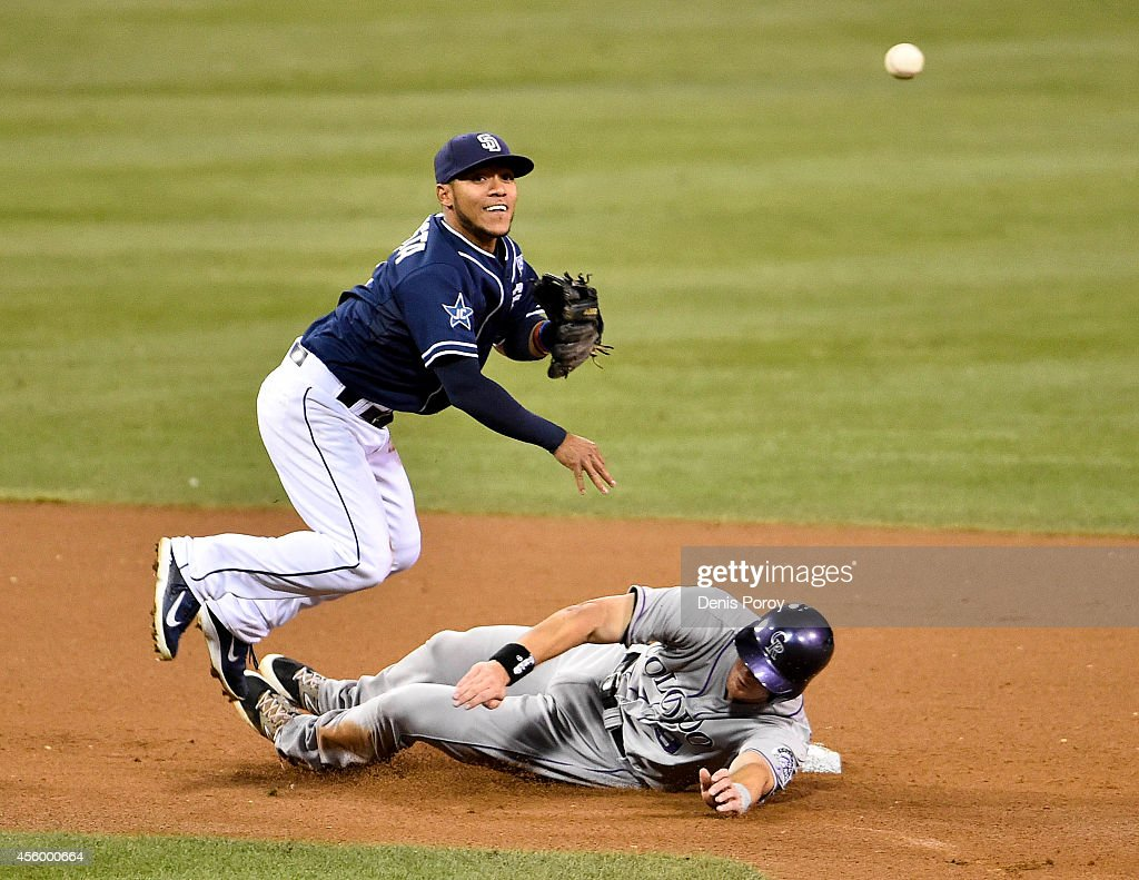 Alexi Amarista #5 of the San Diego Padres throws over DJ LeMahieu #9 of the Colorado Rockies as he turns a double play during the fourth inning of a baseball game at Petco Park September, 23, 2014 in San Diego, California.