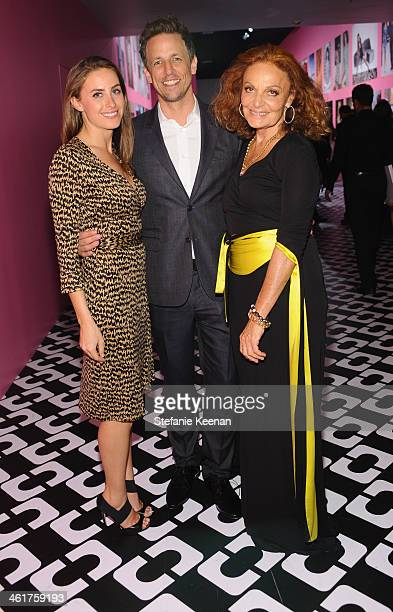 Alexi Ashe, wearing Diane Von Furstenberg, actor Seth Meyers, and Diane Von Furstenberg attend Diane Von Furstenberg's Journey of A Dress Exhibition...