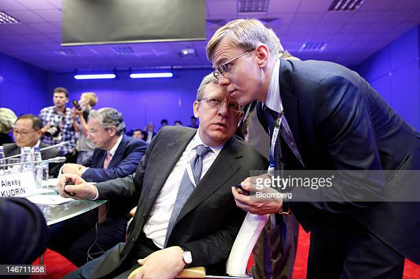 Alexi Kudrin former Russian finance minister center speaks with a colleague during a conference session on day three of the Saint Petersburg...